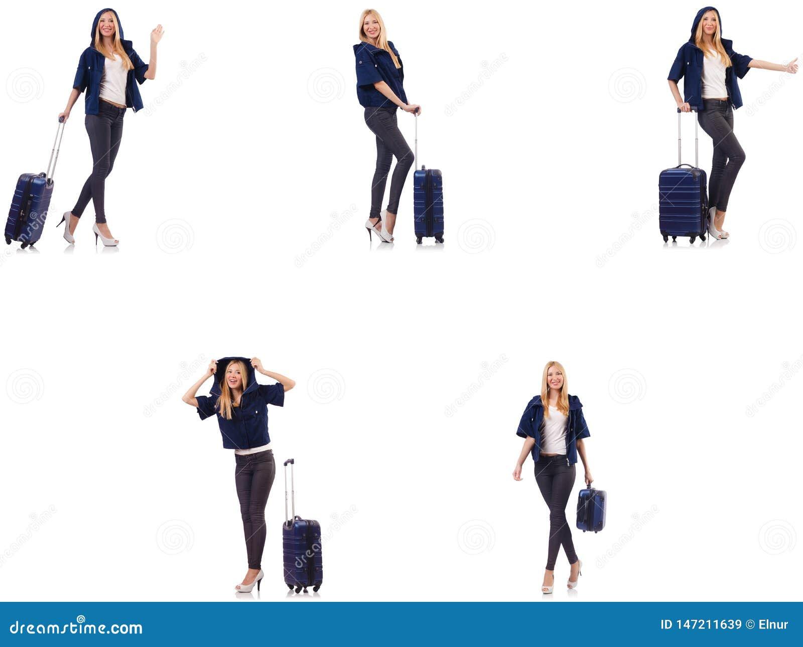 Pi?kna kobieta z walizk? w urlopowym poj?ciu