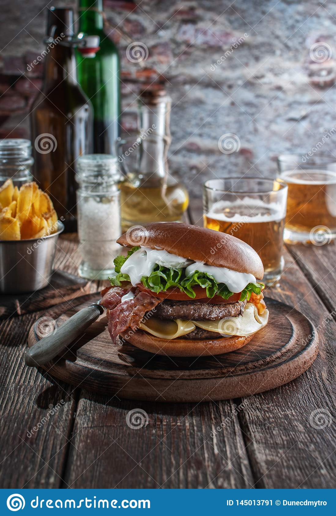 Piano burger with bacon and cutlet with cheese, tomato, greens.