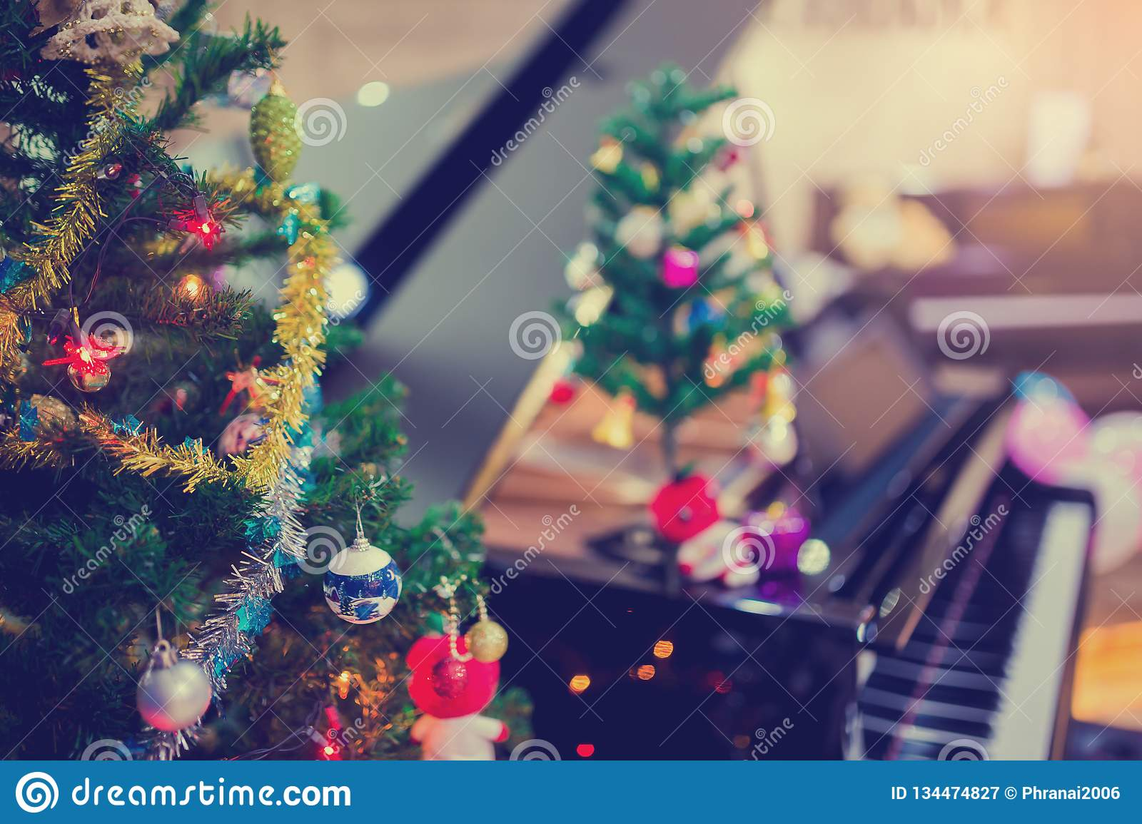 Piano and Christmas tree for christmas holiday background. New Year holidays background royalty free stock photography