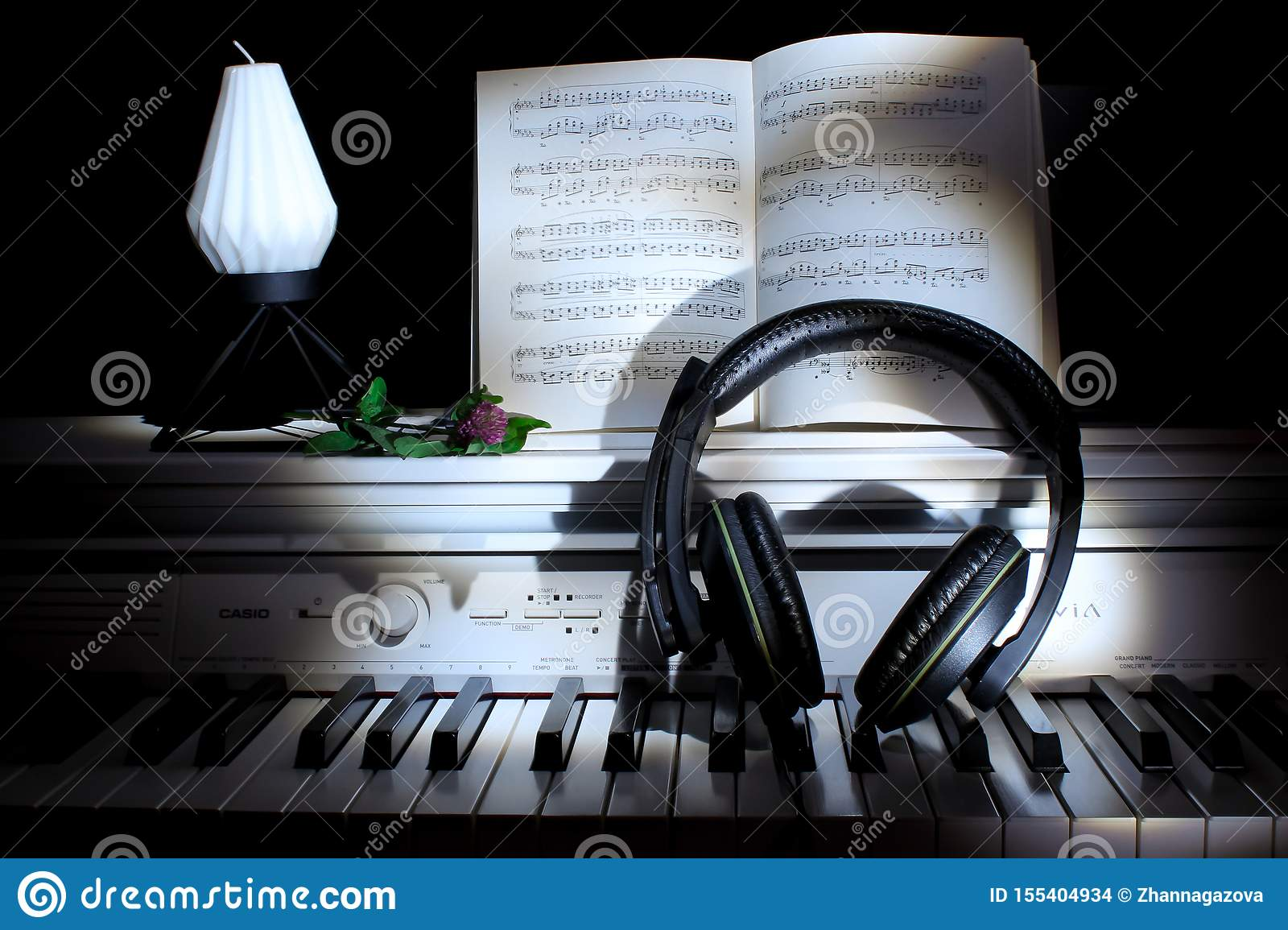 Piano Keys With Notes And Headphones Against A Dark Background Music Concept Picture For Wallpaper Stock Photo Image Of Beautiful Instrument 155404934
