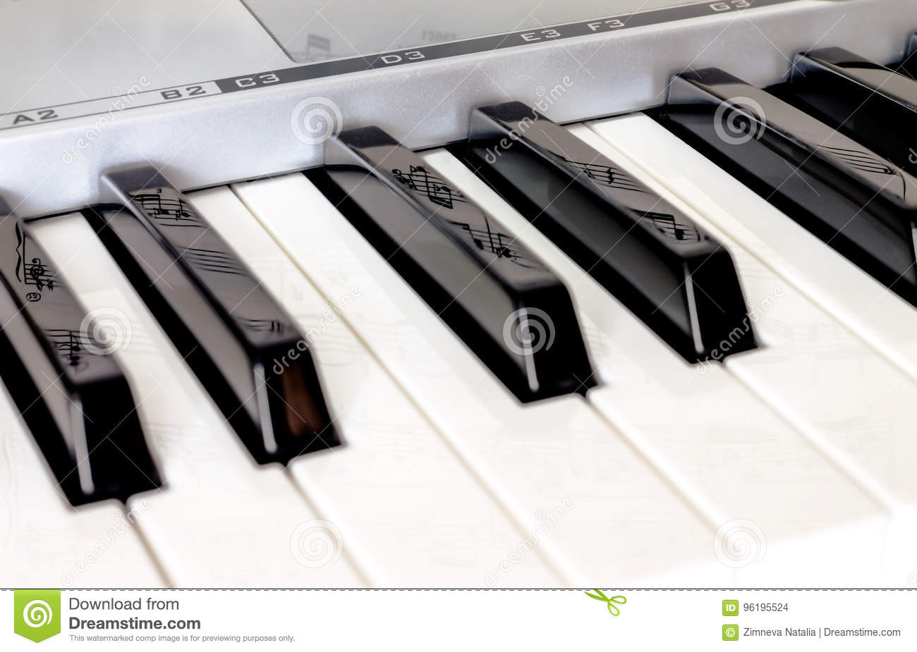 Piano Keys Side View With Reflection Notes On The Keys Stock Photo