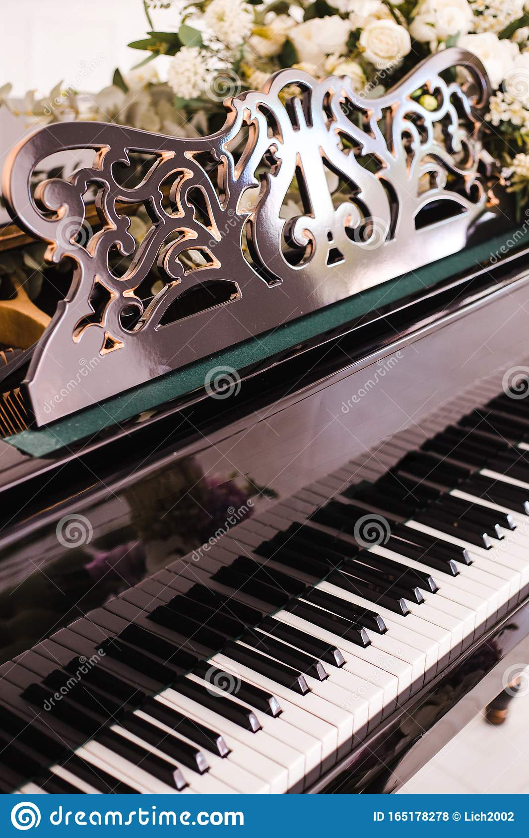 Piano With Open Keys Decorated With A Bouquet Of White ...