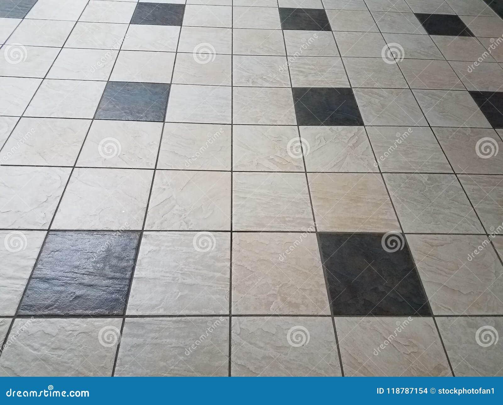 Piastrelle per pavimento in bianco e nero fotografia stock