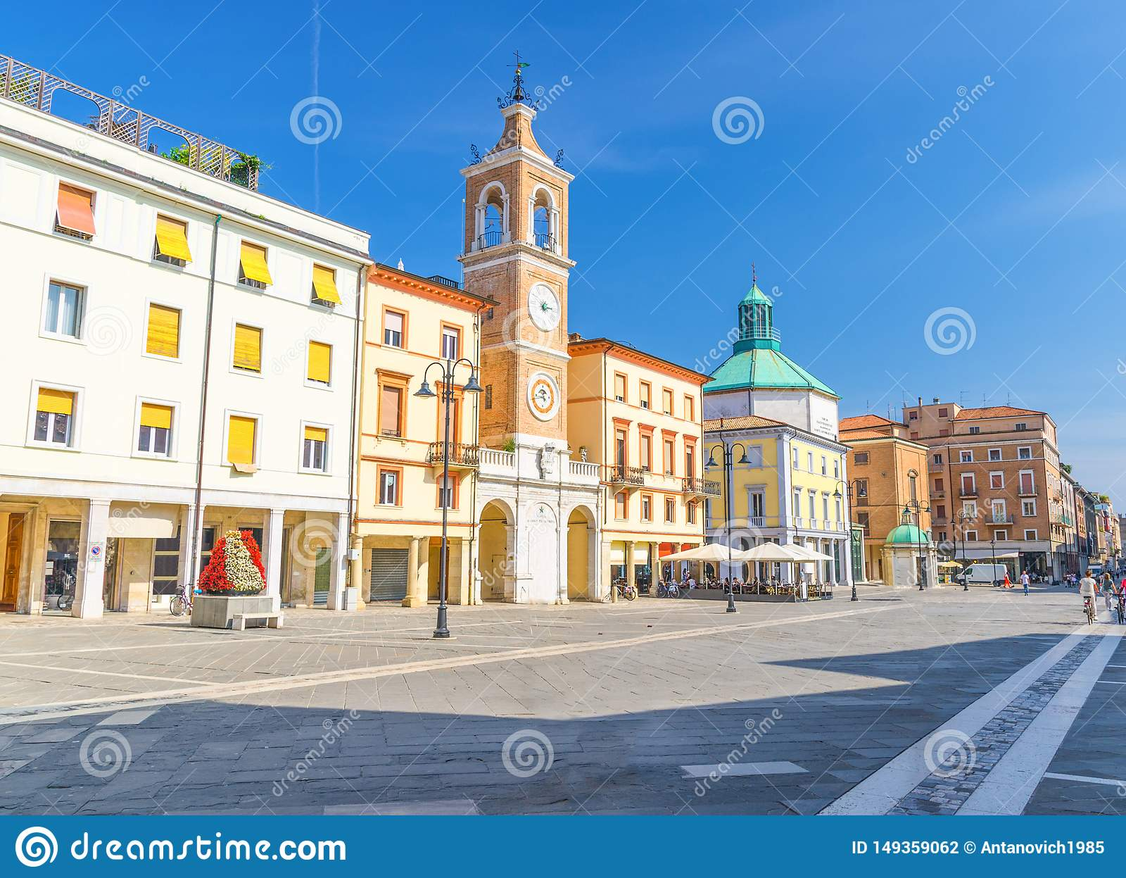 Piazza Tre Martiri Three Martyrs square with traditional buildings with clock and bell tower in Rimini