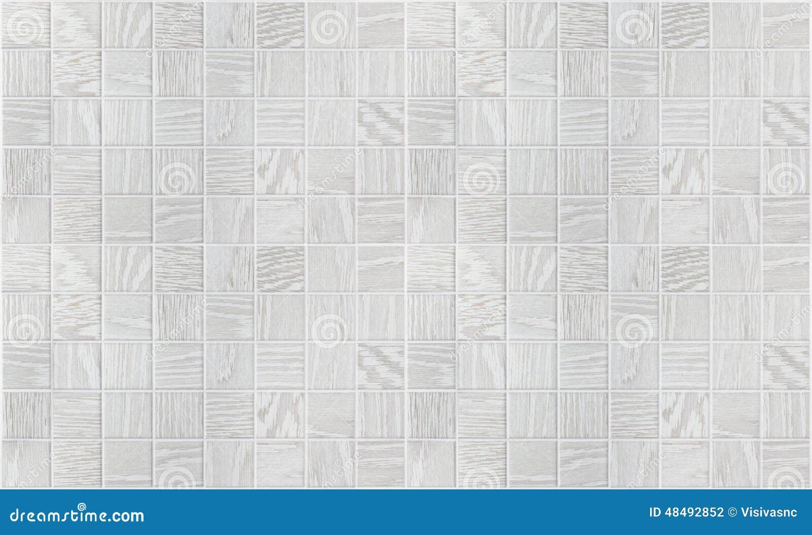 Piccole mattonelle quadrate di marmo grige con gli effetti