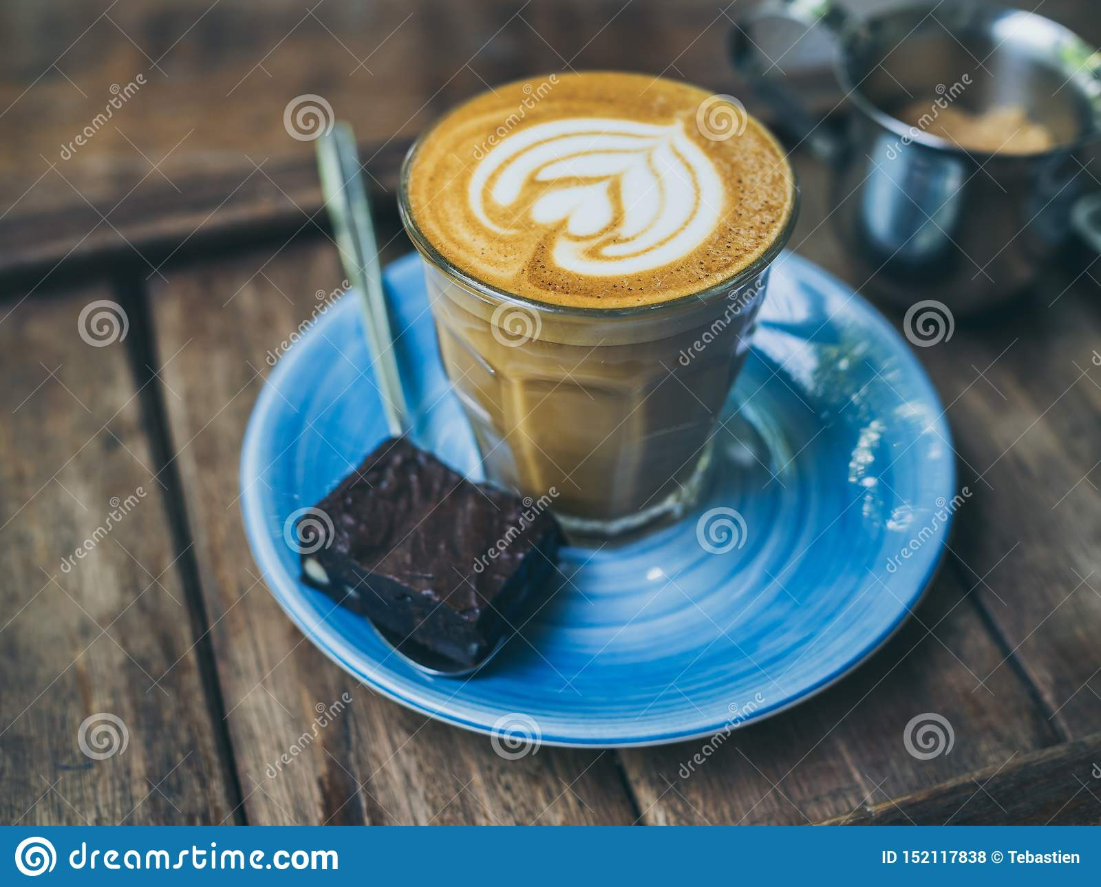 Piccolo Latte Coffee Topping With Flower Art From Milk In Small Glass With A Piece Of Homemade Brownies Cake On Blue Ceramic Plate Stock Photo Image Of Beverage Black 152117838