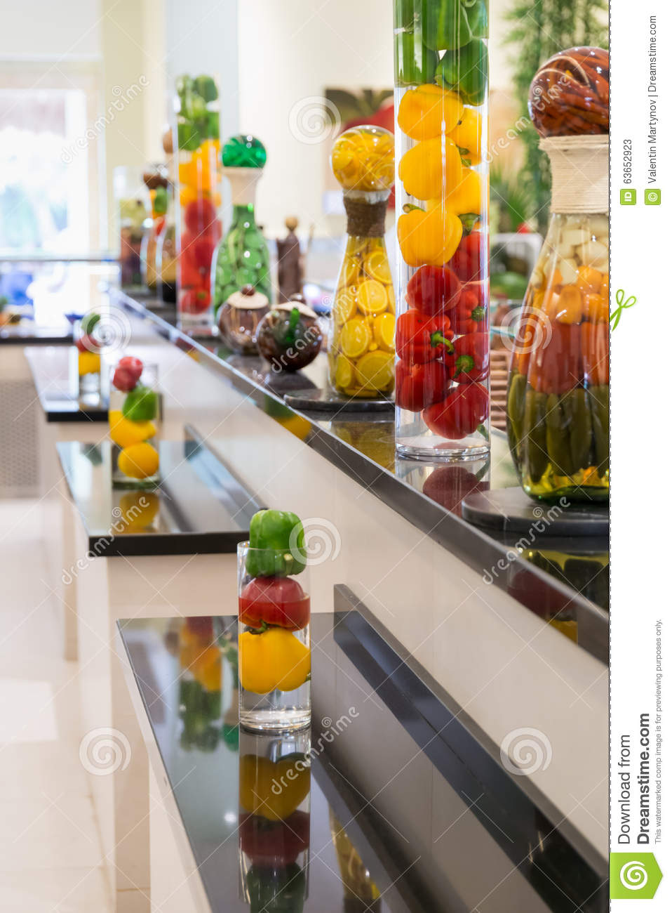 Pickeled vegetables and fruits on a display as