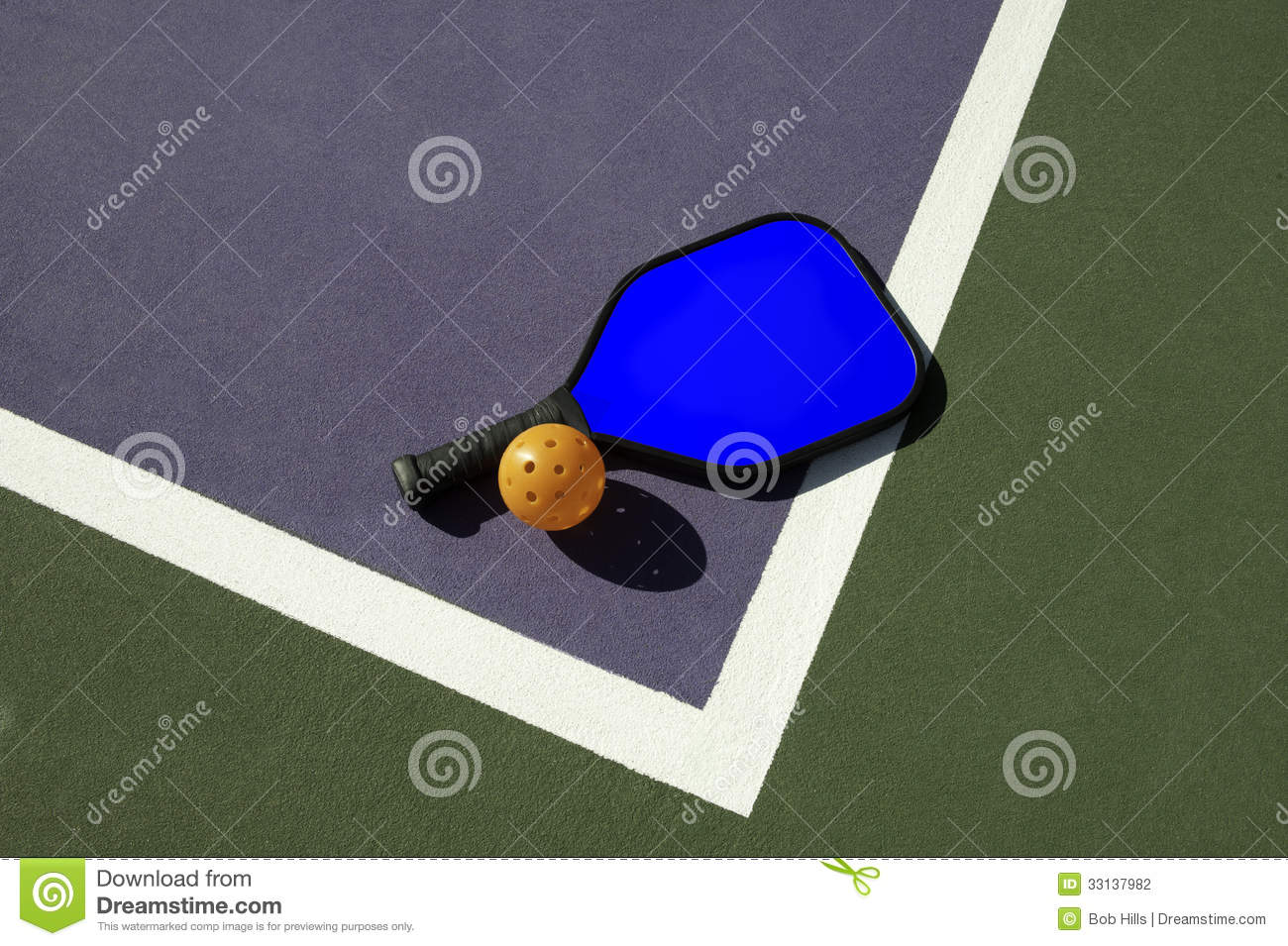 Pickleball and blue paddle on edge of court stock photo for Simple edge