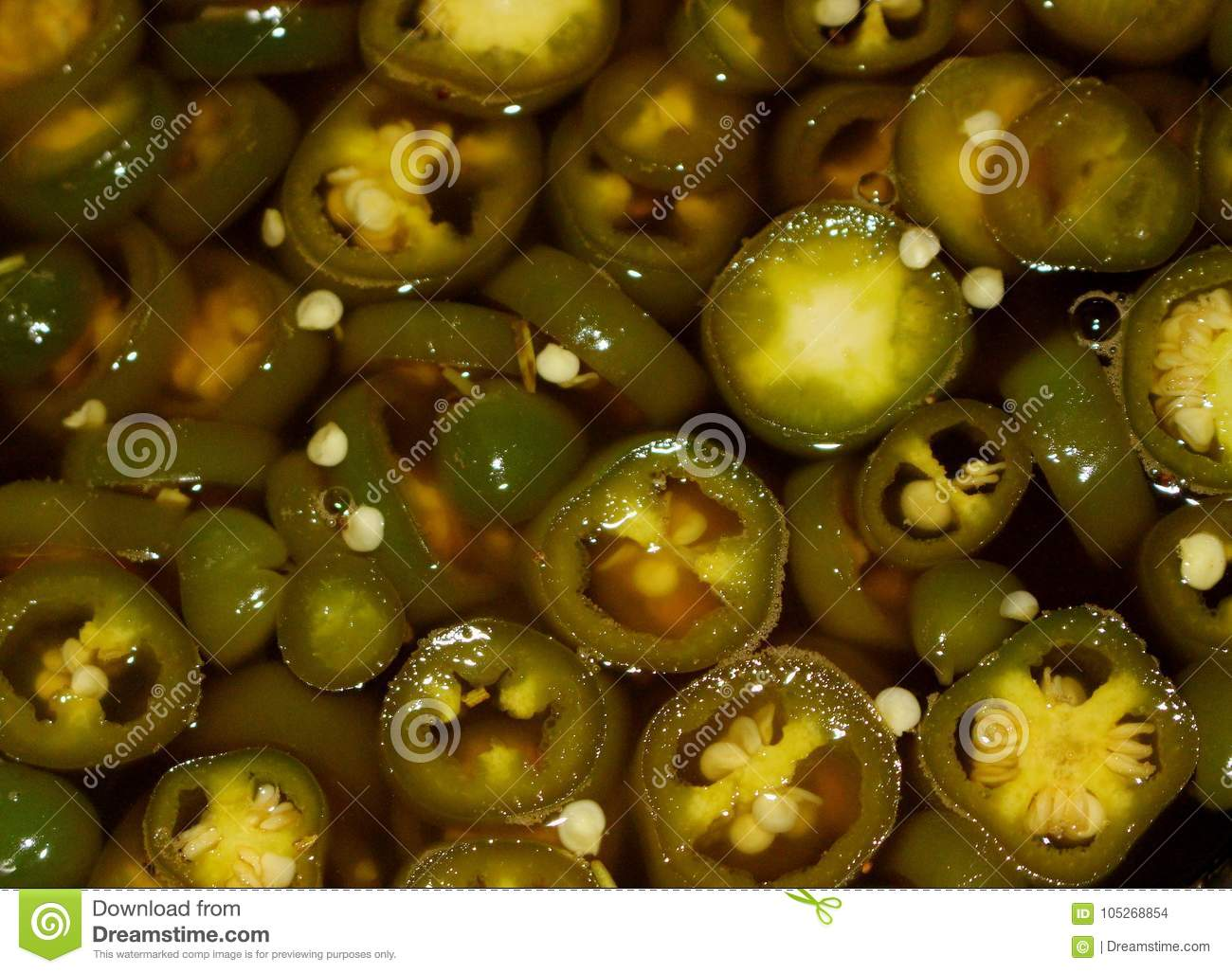 Pickled jalapeno pepper rings in marinade