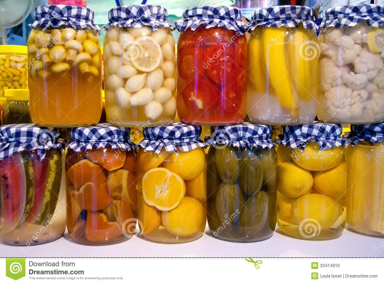 pickled vegetables and fruit in jars royalty free stock