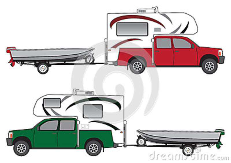 Pickup With Camper Pulling Boat