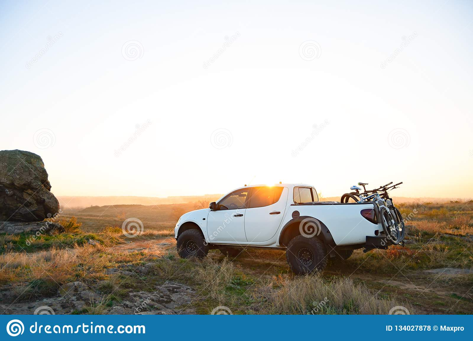 Pickup Offroad Truck With Bikes In The Body In The Mountains