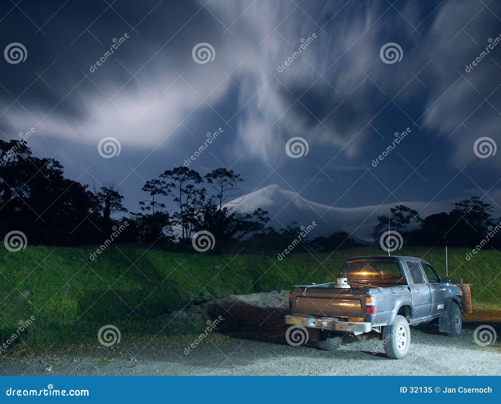 Pickup truck in moonlight near Arenal Volcano