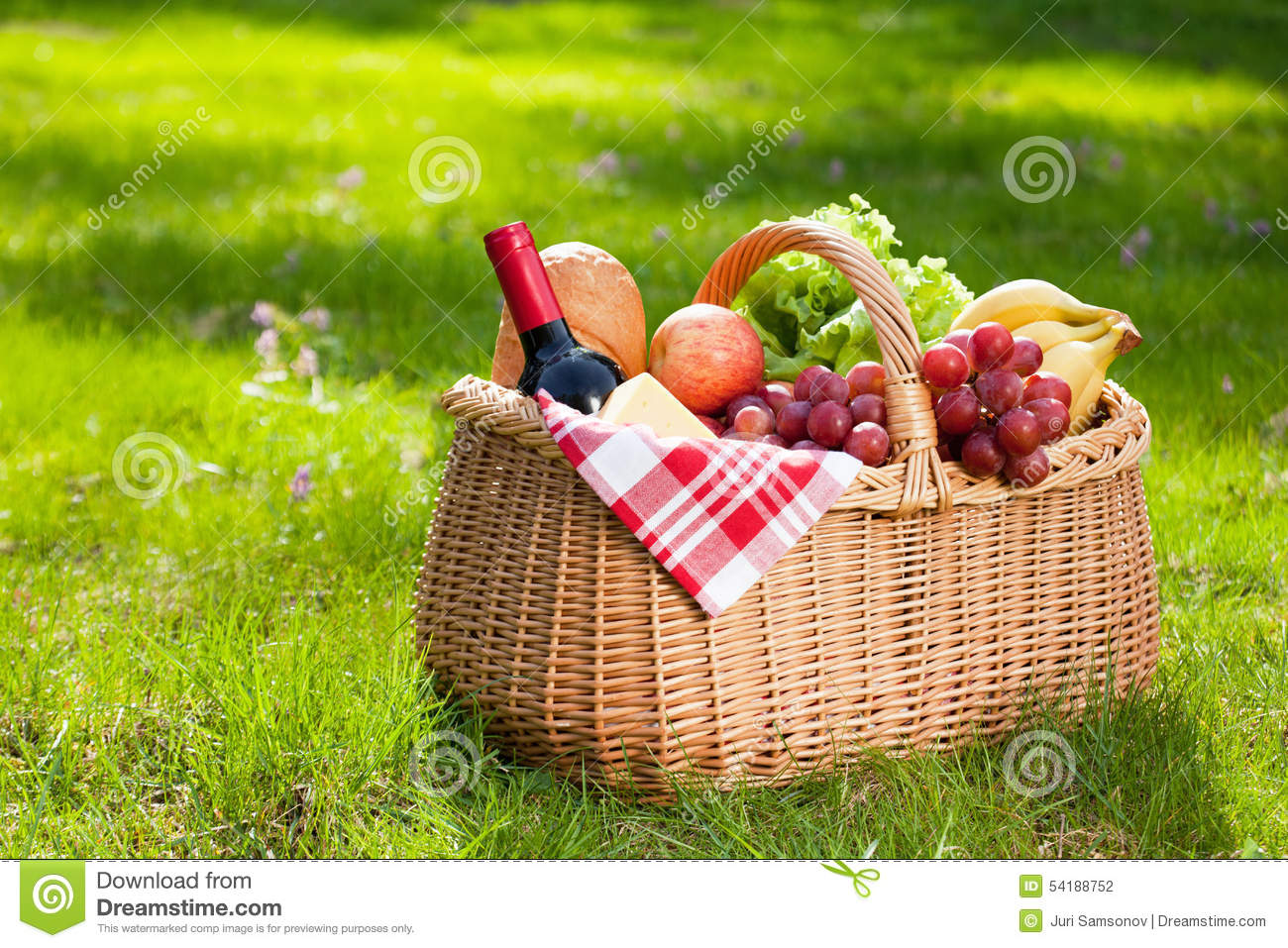 Picnic Basket With Food On Green Grass Stock Photo