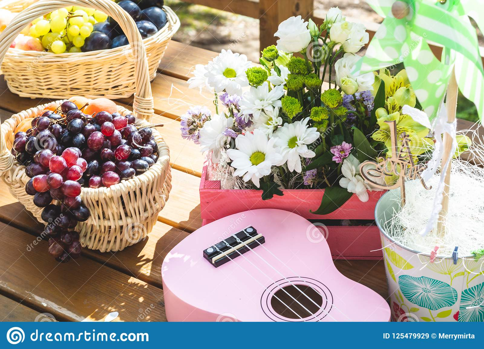 Picnic Party Table Decoration Baskets With Fruits On A Wooden Table Flowers Pink Small Guitar And Pinwheel Stock Image Image Of Garden Fruit 125479929
