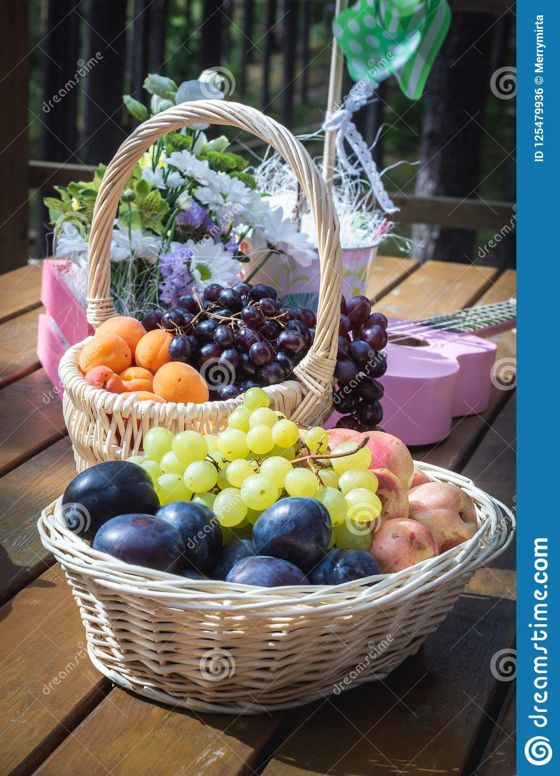 Picnic Party Table Decoration Baskets With Fruits On A Wooden Table Flowers Pink Small Guitar And Pinwheel Stock Photo Image Of Outdoors Occasion 125479936