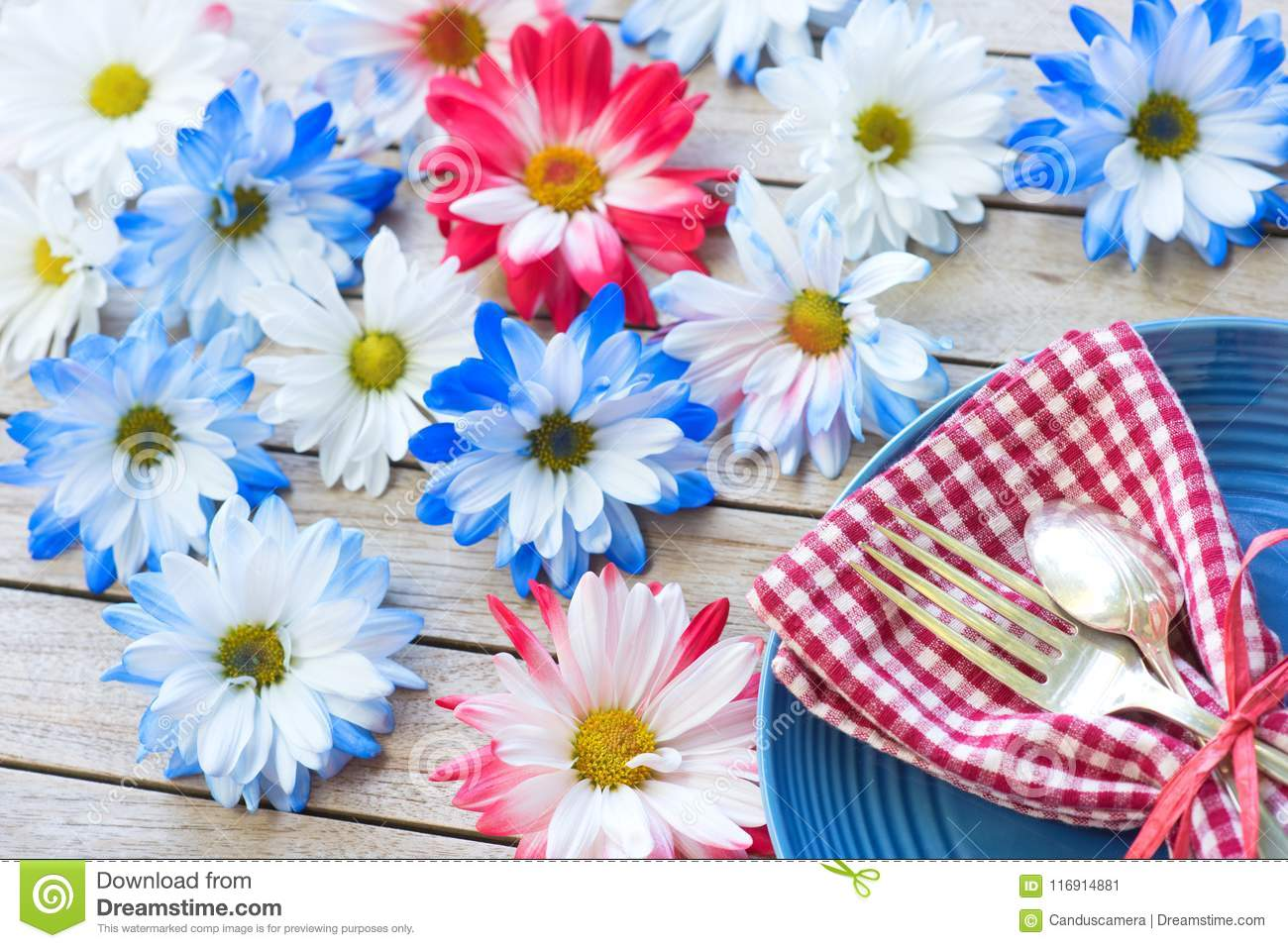 Picnic Table Setting in Red White and Blue Colors for July 4th Celebration on Wood Board Background Table with room or space for c