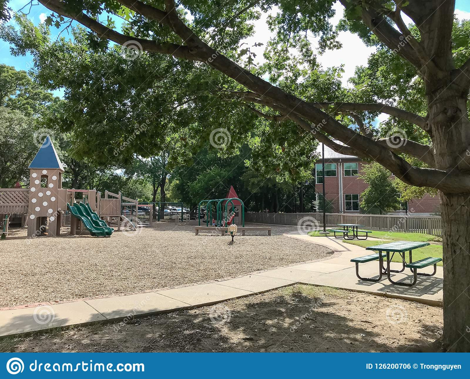 Picnic Tables At Public Wooden Castle Style Children Playground