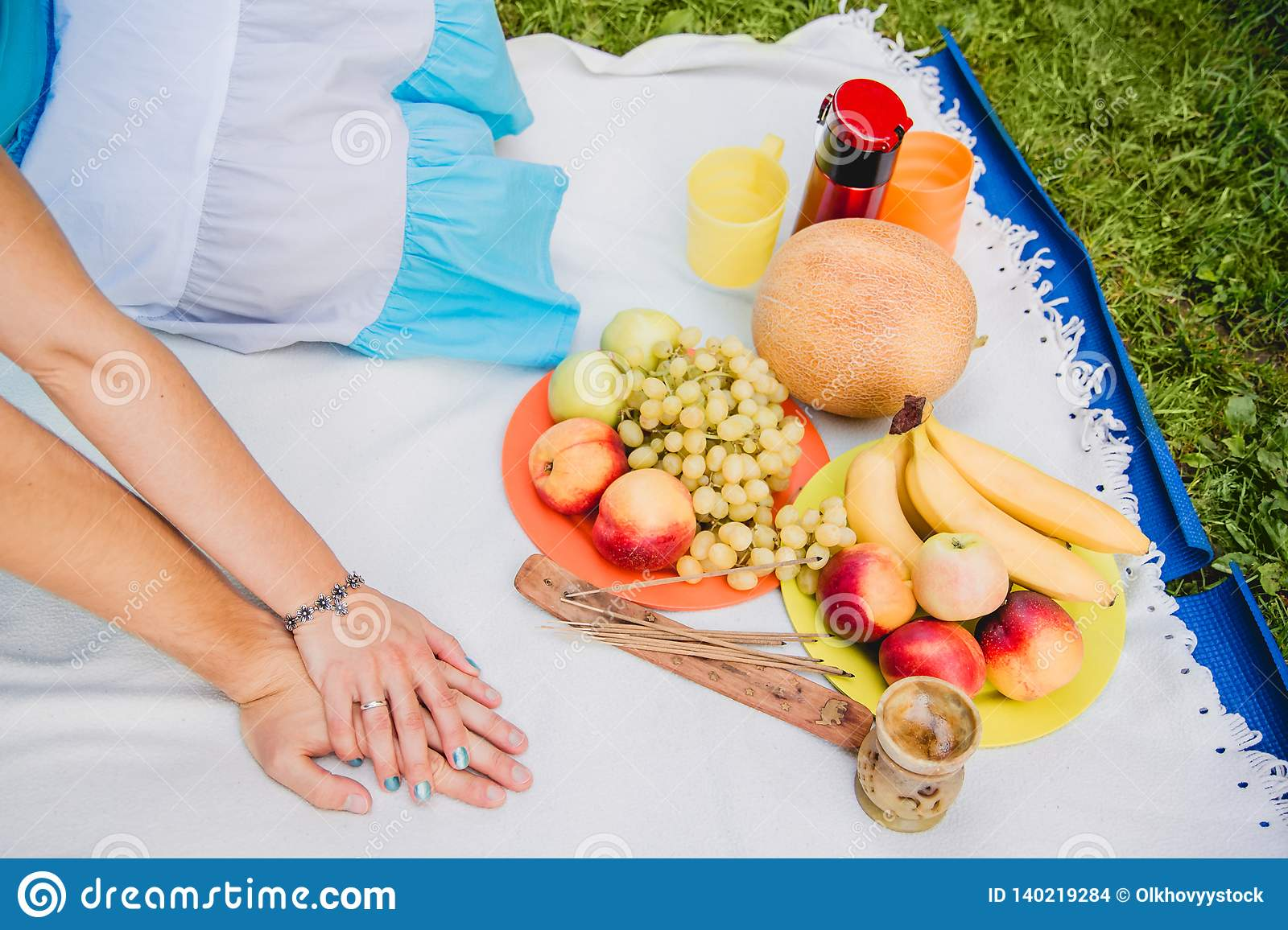 Picnic time. Young couple eating grapes and enjoying in picnic. Love and tenderness, dating, romance, lifestyle concept