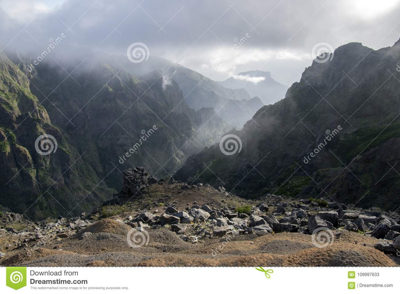 Pico do Arieiro hiking trail, amazing magic landscape with incredible views, rocks and mist, view of the valley between rocks