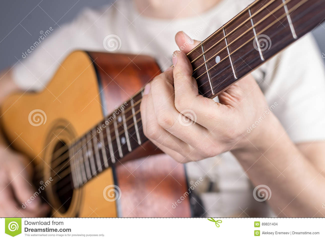 A Picture Of An Acoustic Guitar Classical Color In The Hands Of A
