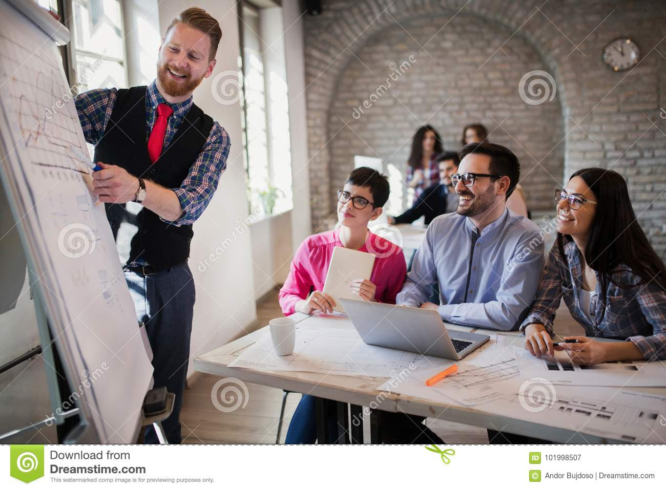 Picture of architect doing presentation to his colleagues