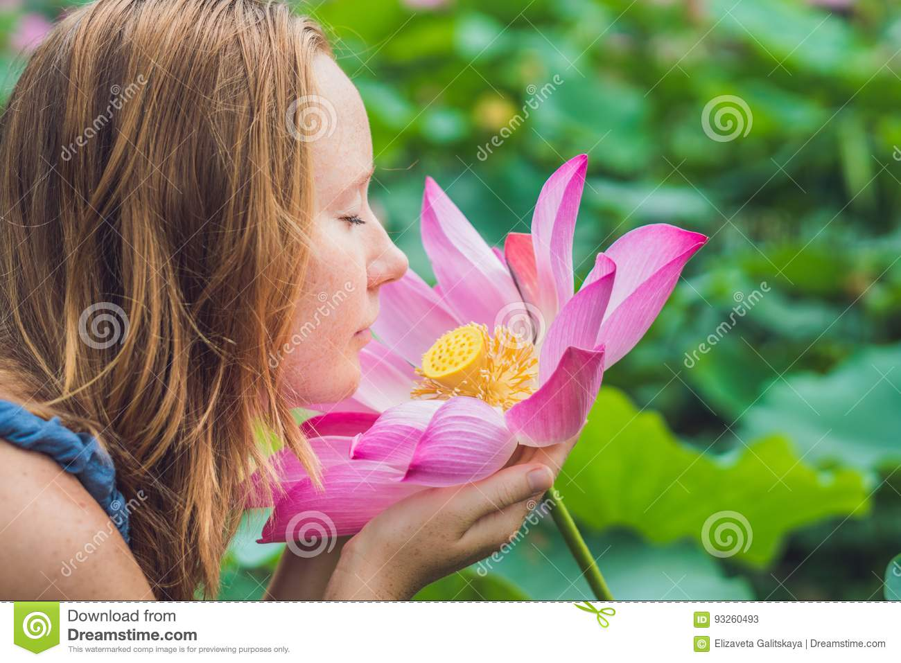 Picture of beautiful red haired woman with lotus flower in hand download picture of beautiful red haired woman with lotus flower in hand stock image mightylinksfo