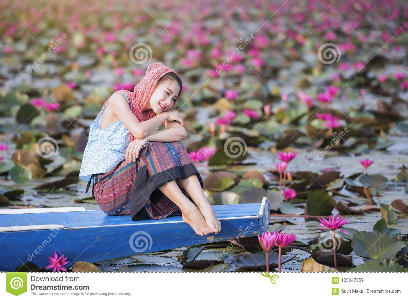 Beautiful Woman With Lotus Flower At The Red Lotus Sea Stock Image