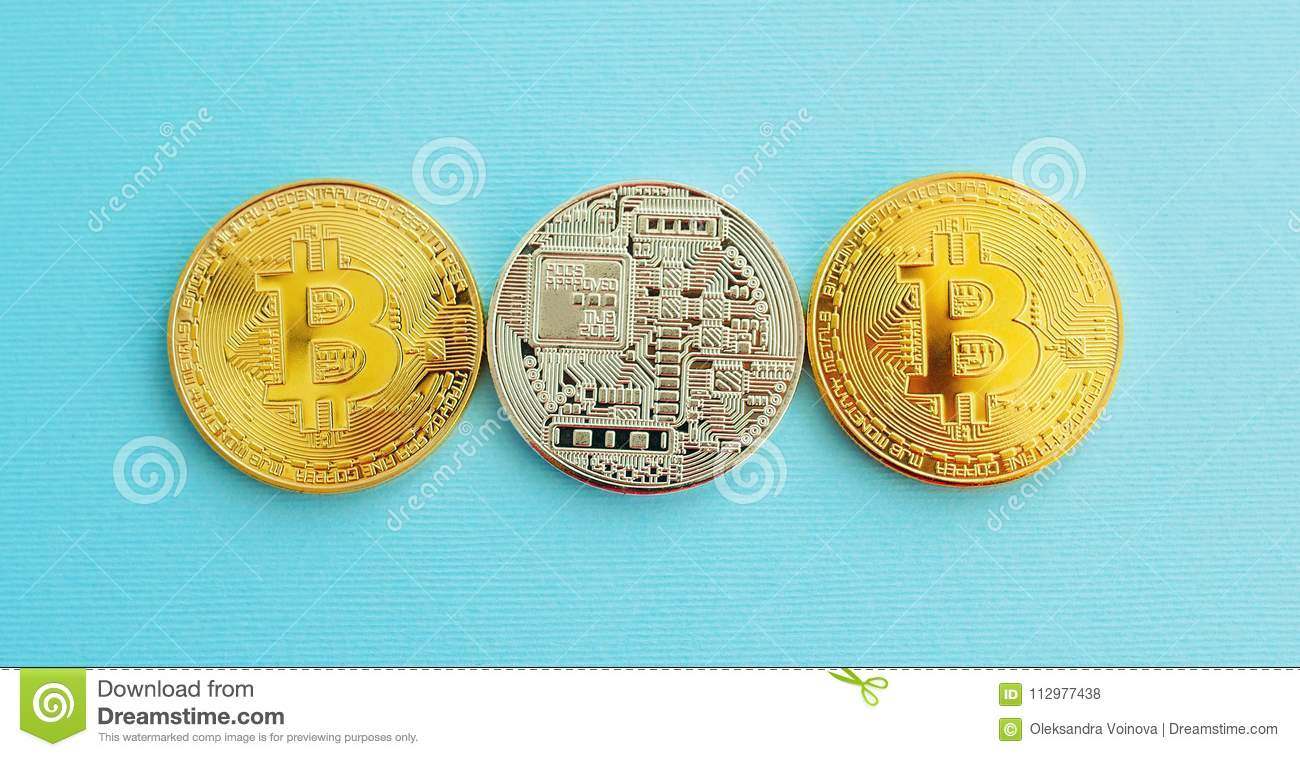 Picture of three gold bitcoin over blue background. Digital money concept