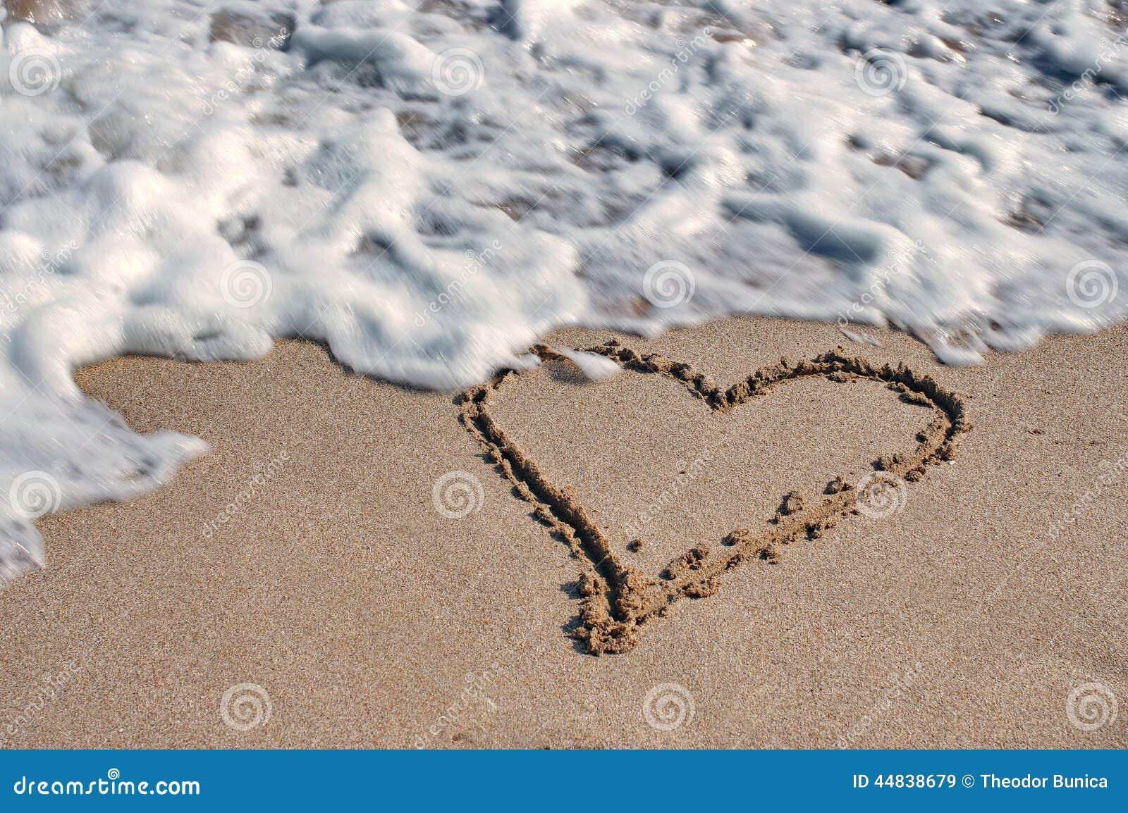 Seascape. Love, summer, sea, sun, beach, fun, holiday and a big heart on the sand