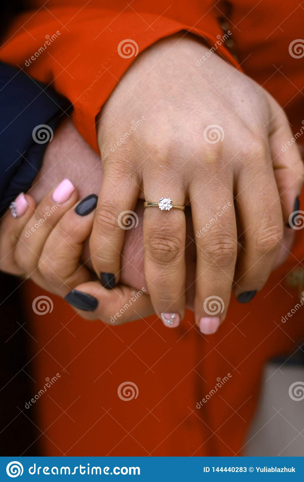 Picture of man and woman hands with wedding ring