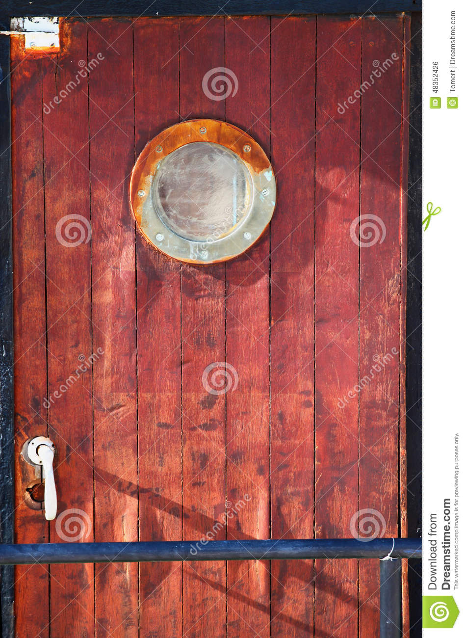 Picture Of Old Ship Door With A Round Window Stock Photo
