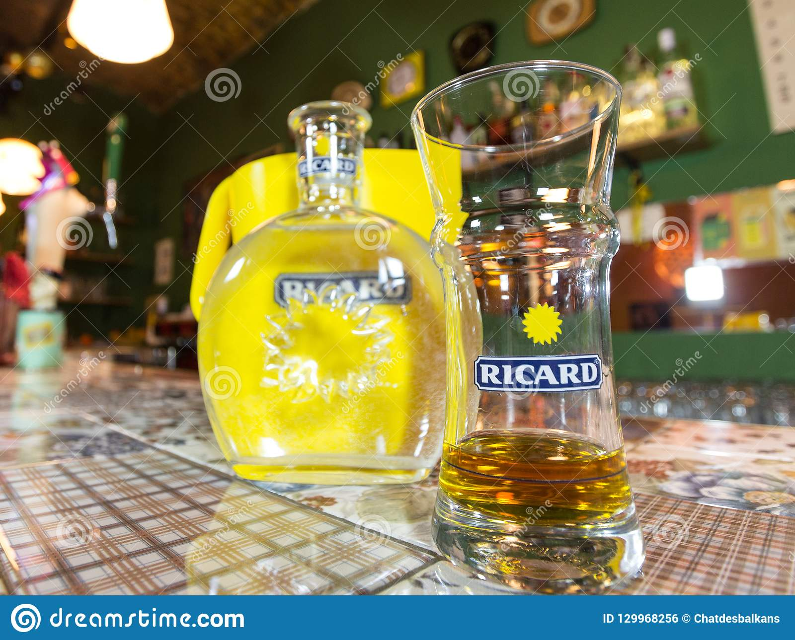 Close of on a Ricard jug and a water bottle with its logo. Ricard is a pastis, an anise and licorice flavored aperitif