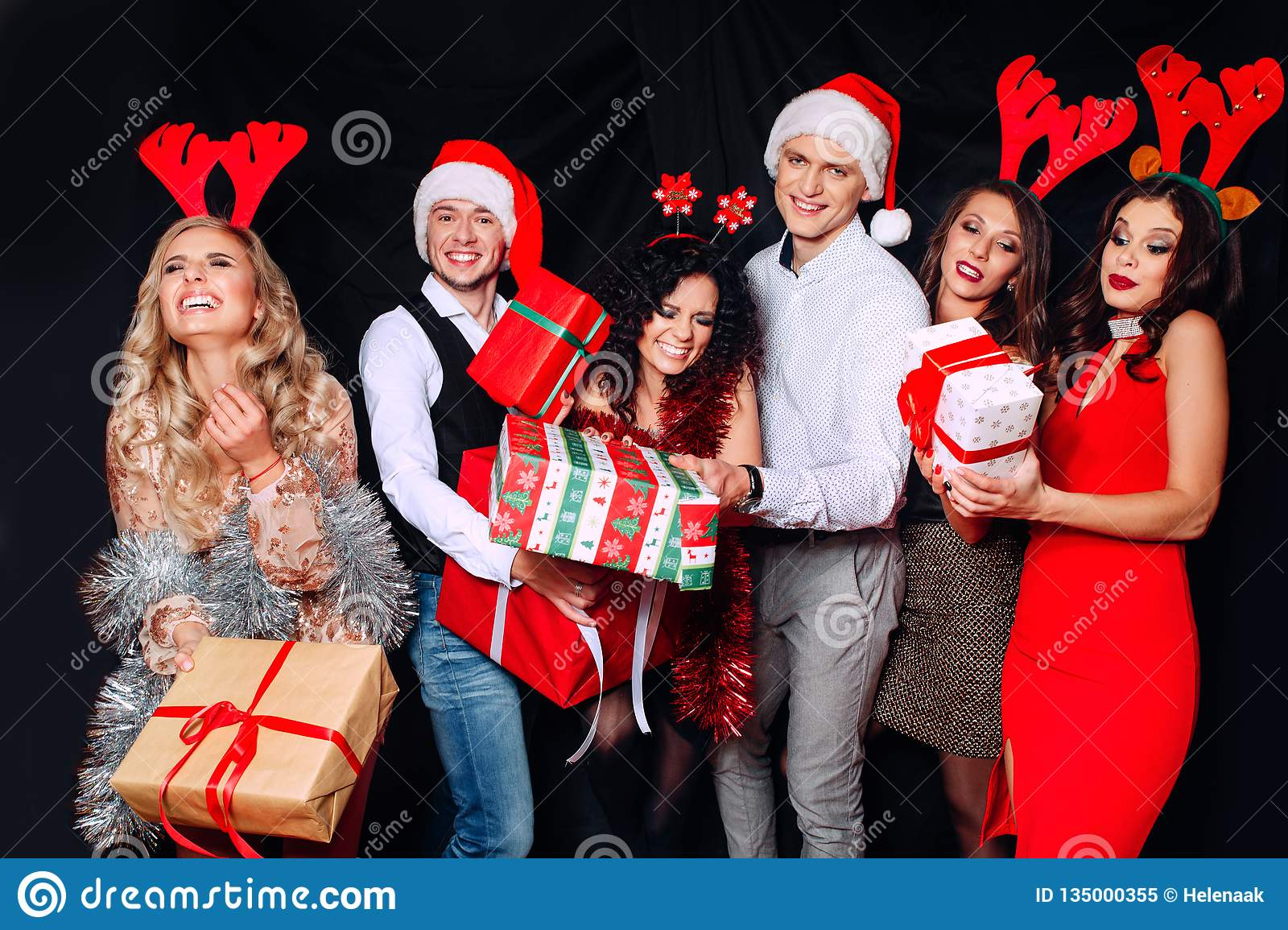 Picture Showing Group Of Friends With Christmas Presents Friends