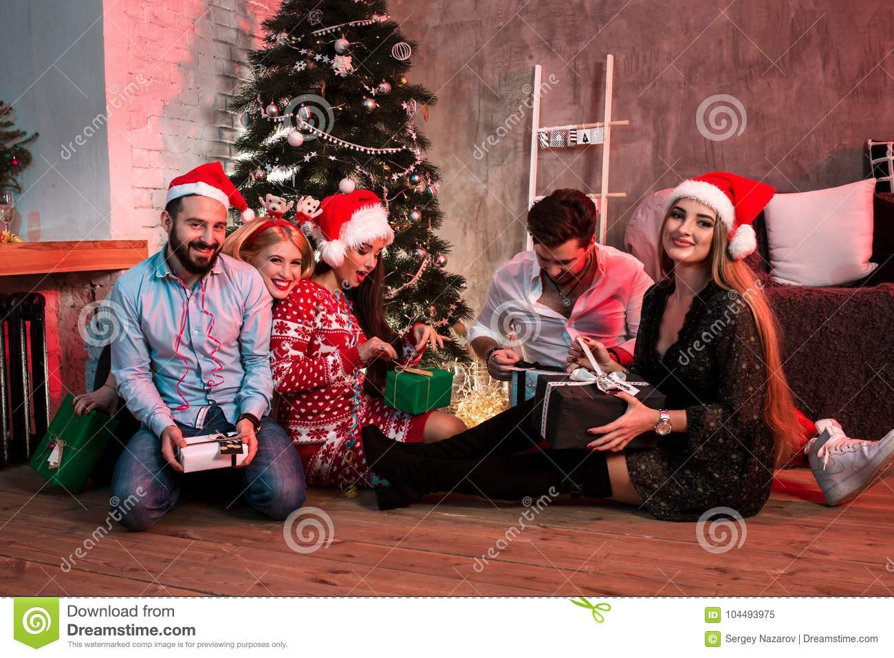 Picture Showing Group Of Friends With Christmas Presents On Party