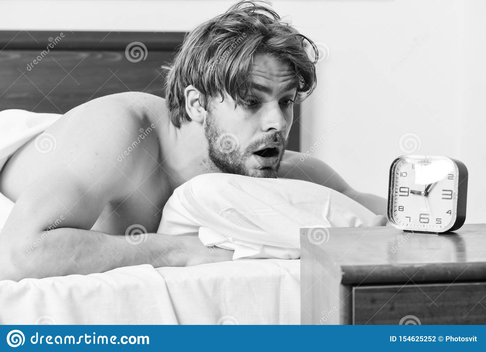Picture Showing Young Man Stretching In Bed. Guy Is Lying