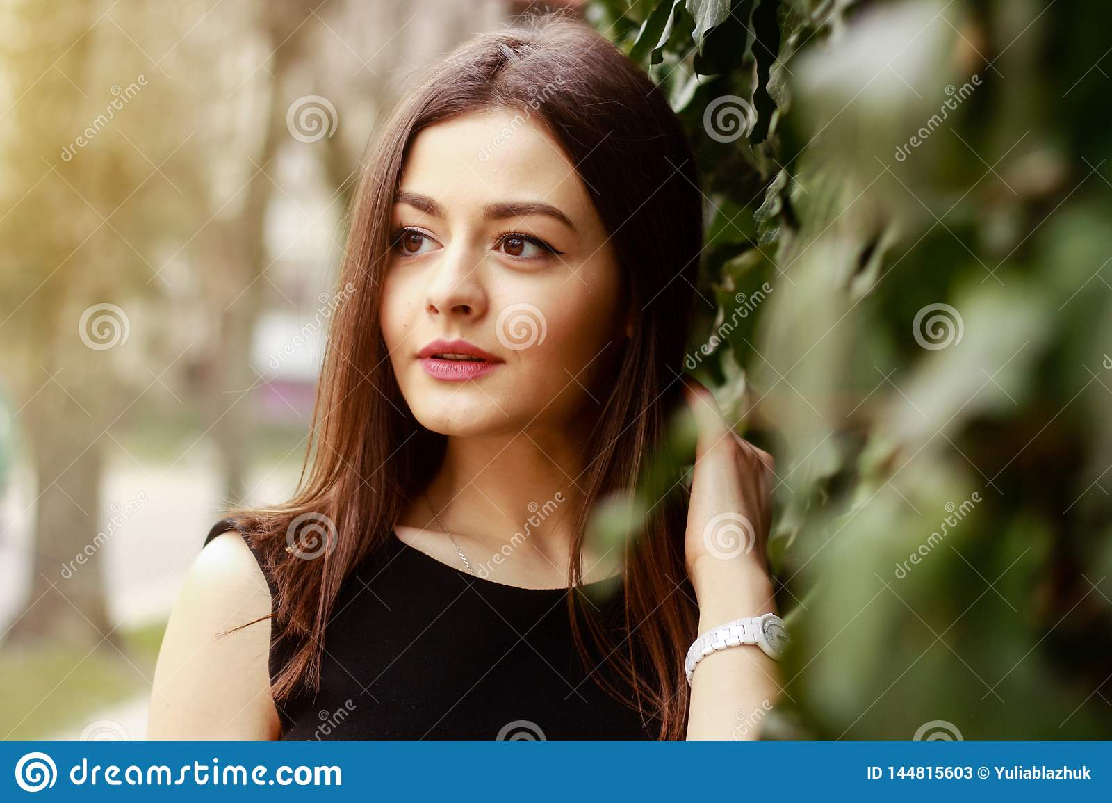 Picture of thoughtful young pretty woman at street