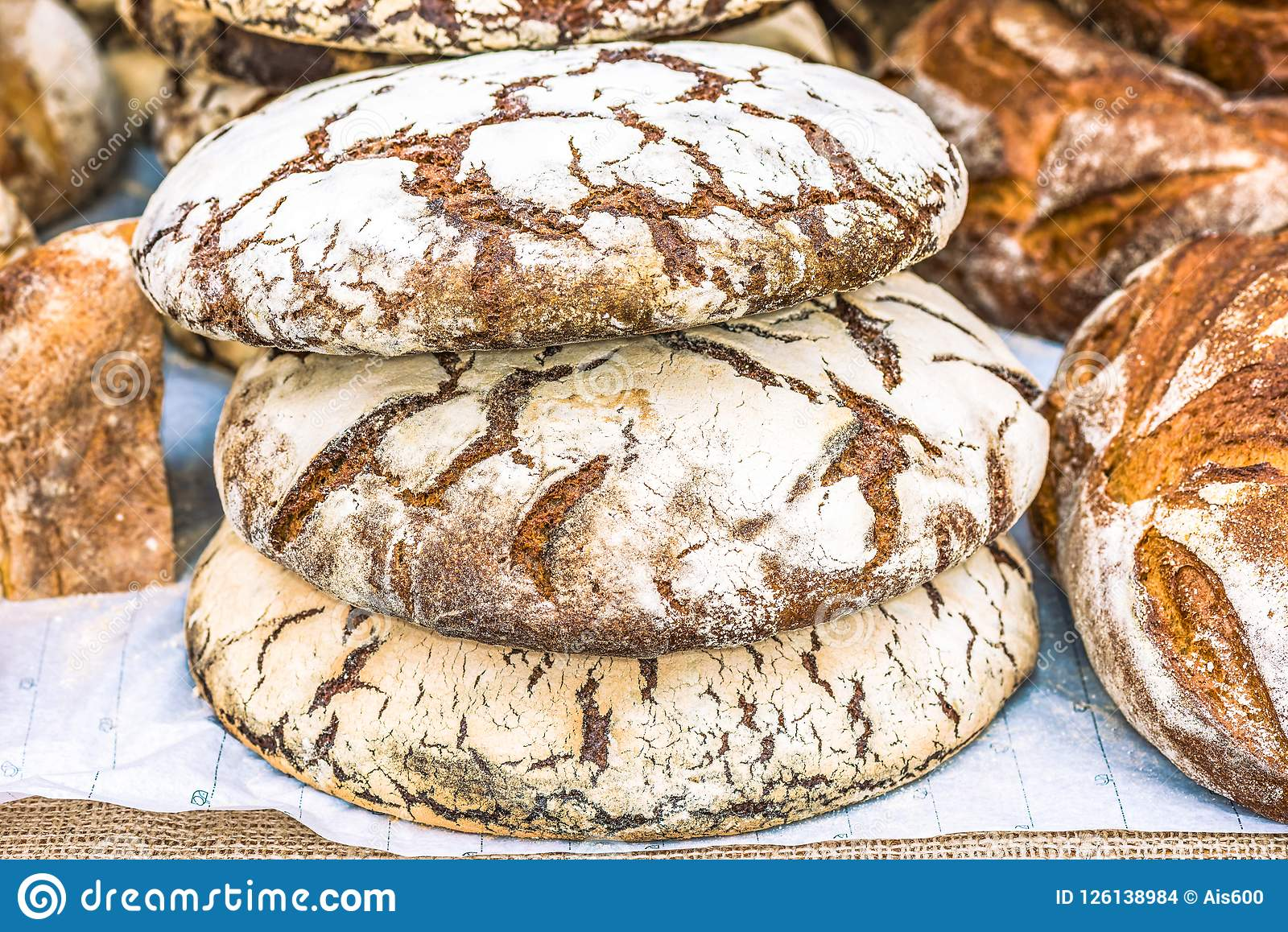 Round loaves of wheat bread on the table, Kiev, Ukraine.
