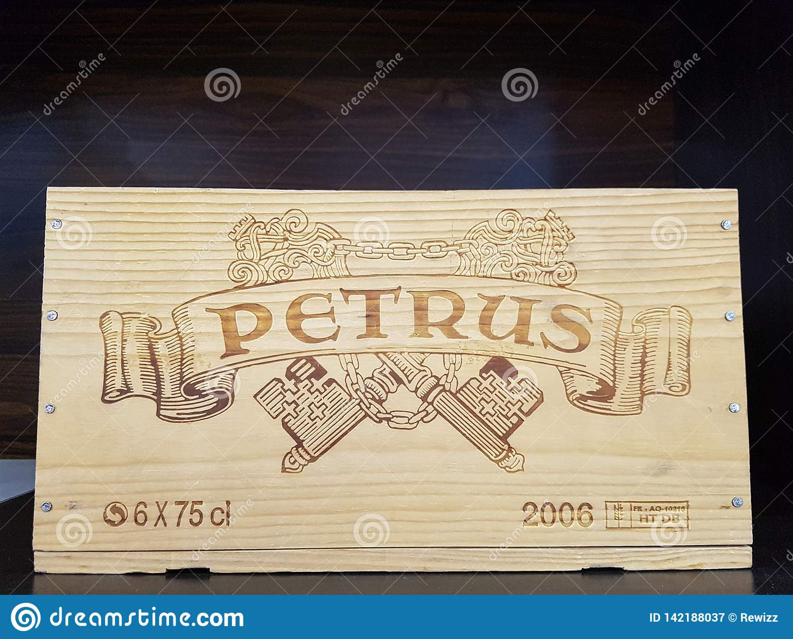 Picture Of A Wooden Case Of Petrus, A Red Wine That Is Known