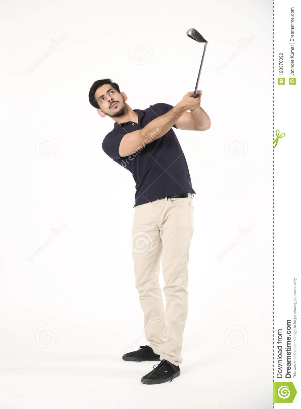 Boy playing with golf stick