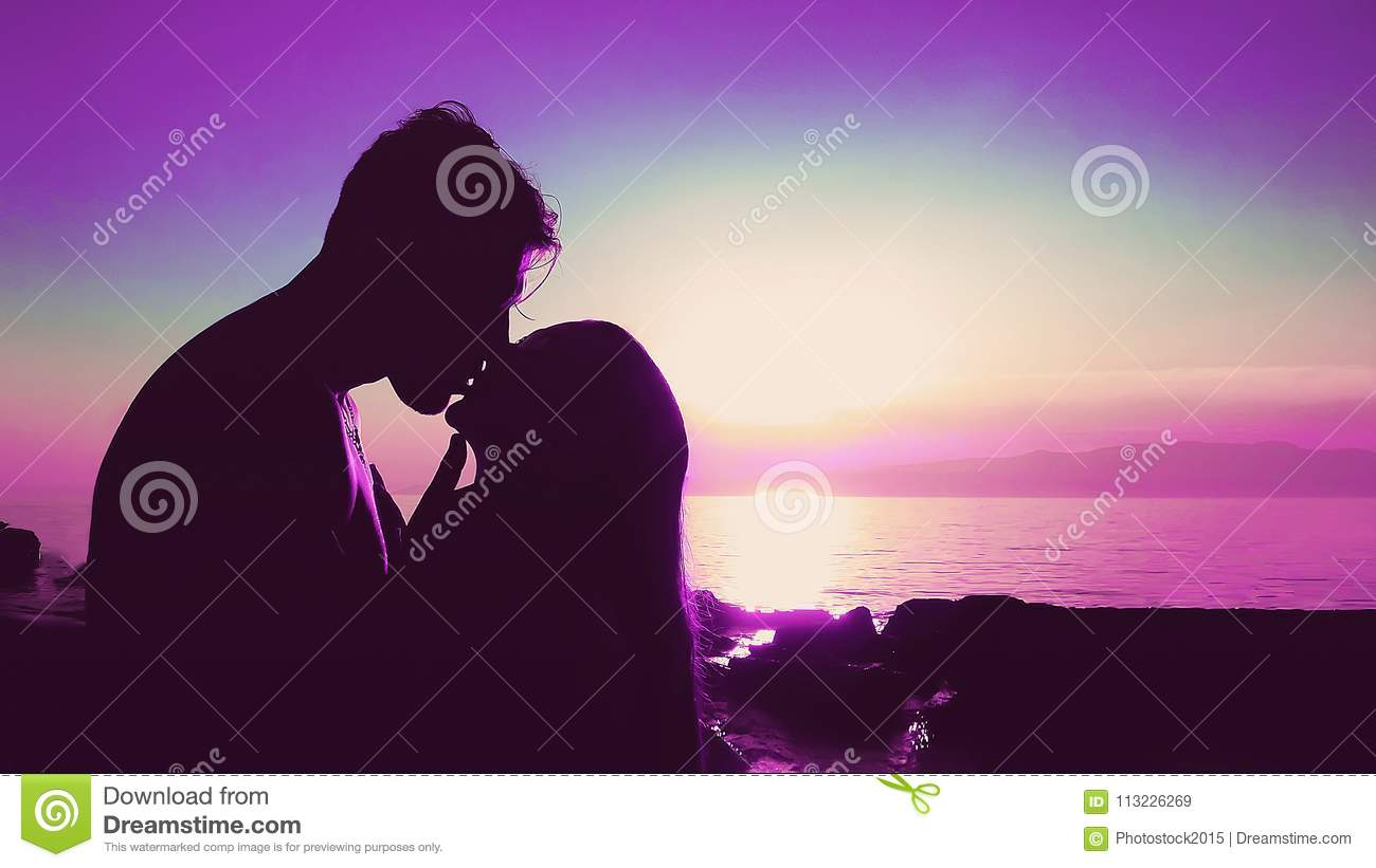 Kissing on the beach