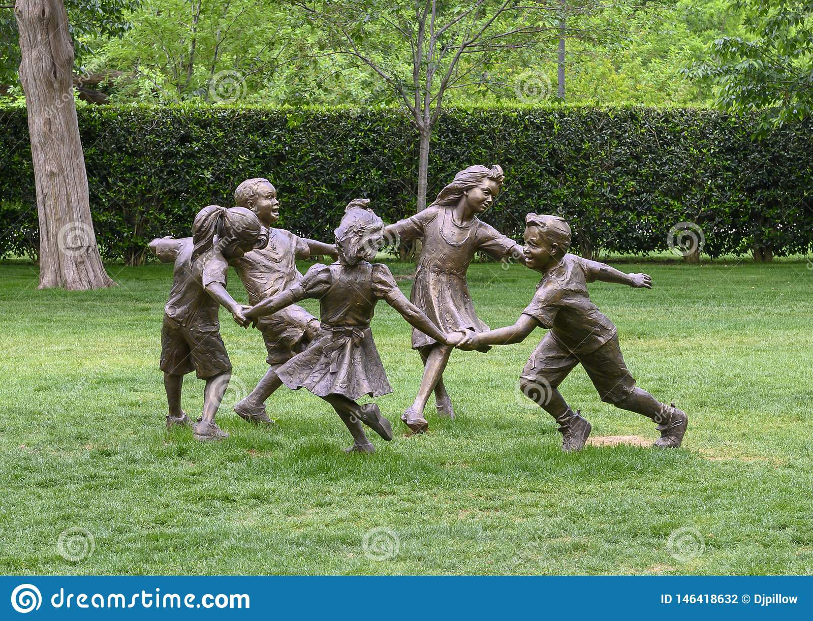 Bronze sculpture of children holding hands running in a circle by Gary Price at the Dallas Arboretum and Botanical Garden