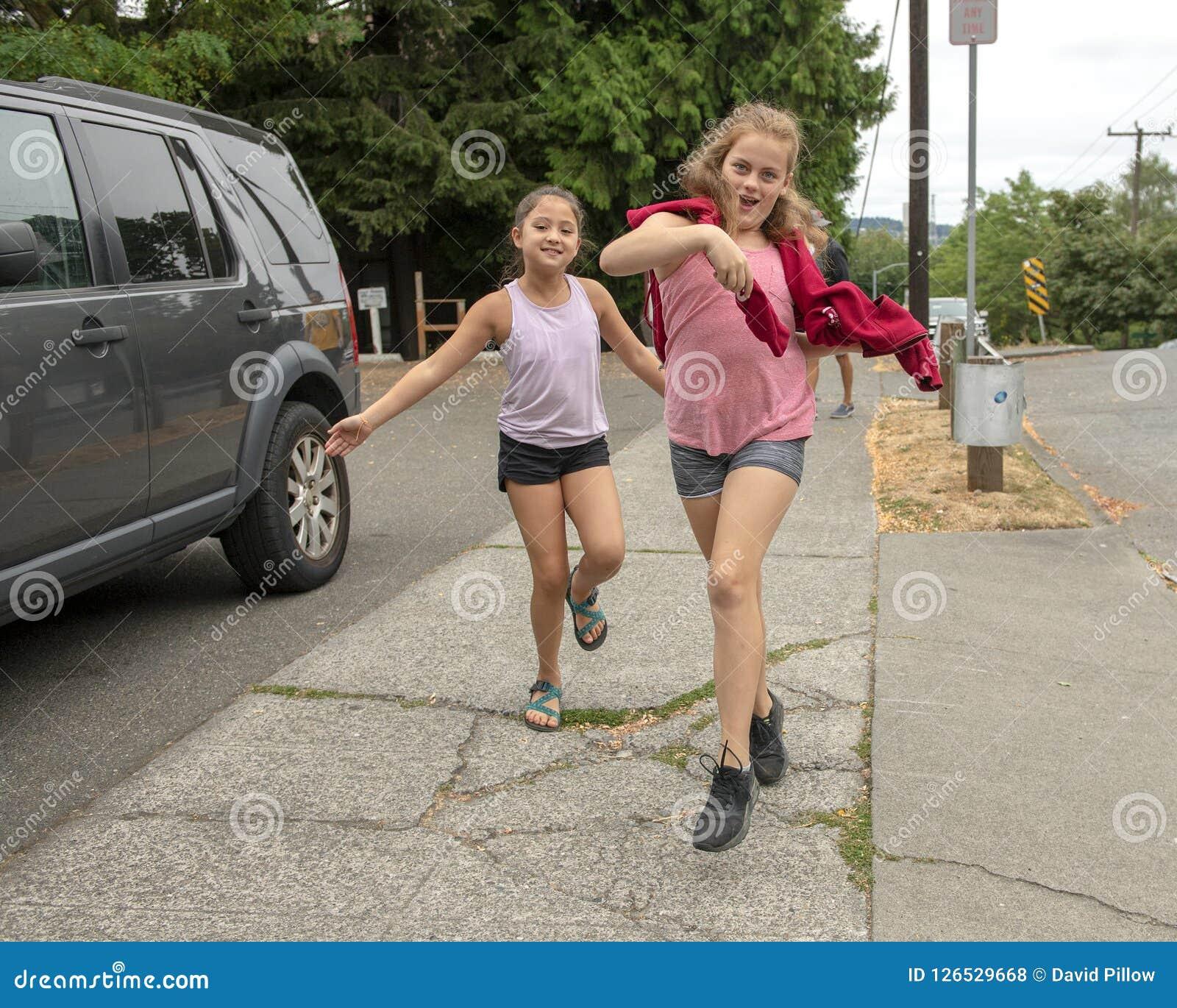 Cousins having fun coming down the street in Seattle, Washington