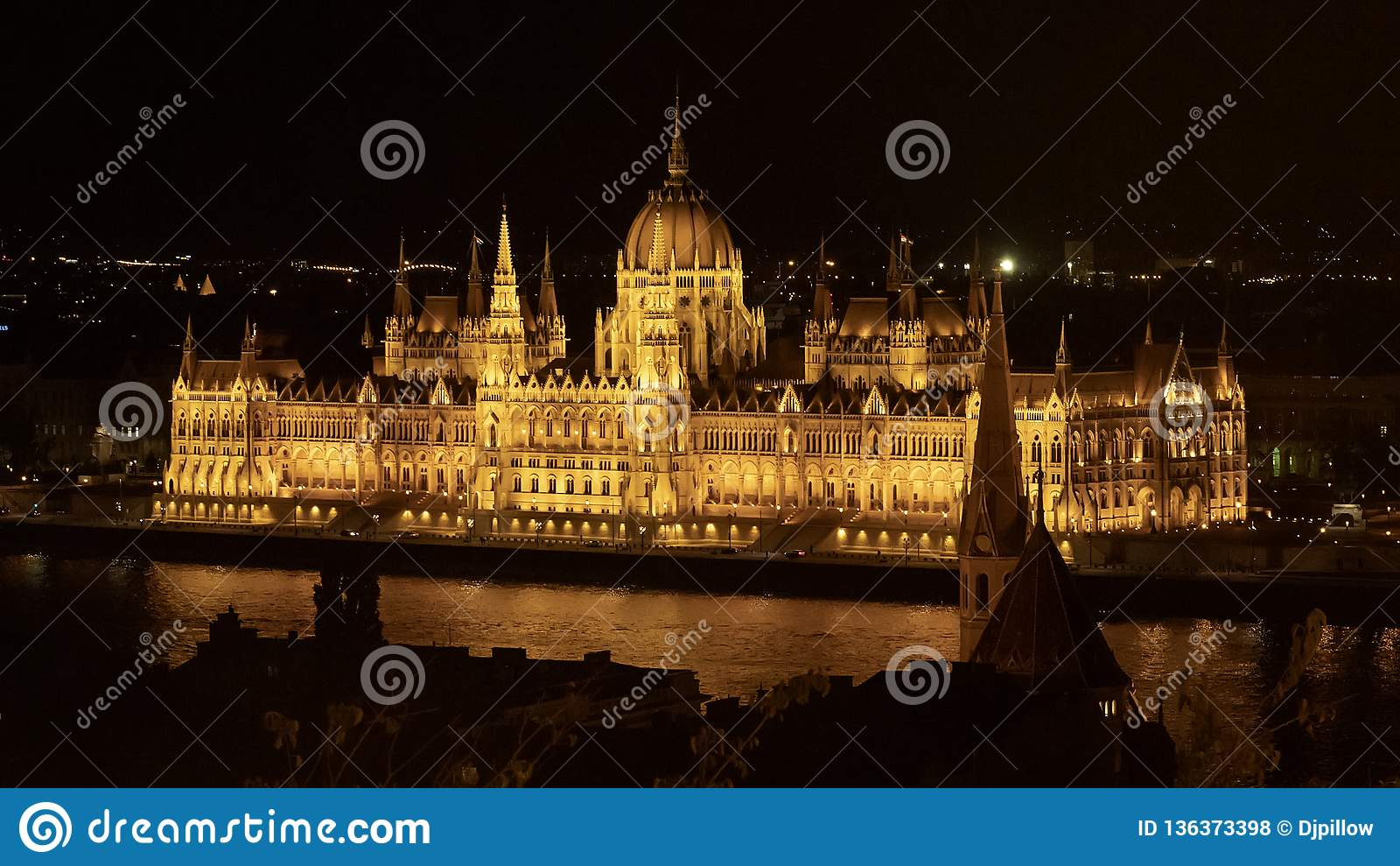 The Hungarian Parliament Building at night, from the Pest side of the River Danube, Hungary