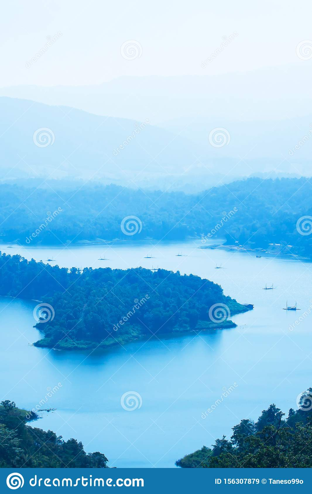 Picturesque aerial view of the blue lake in a mountain range