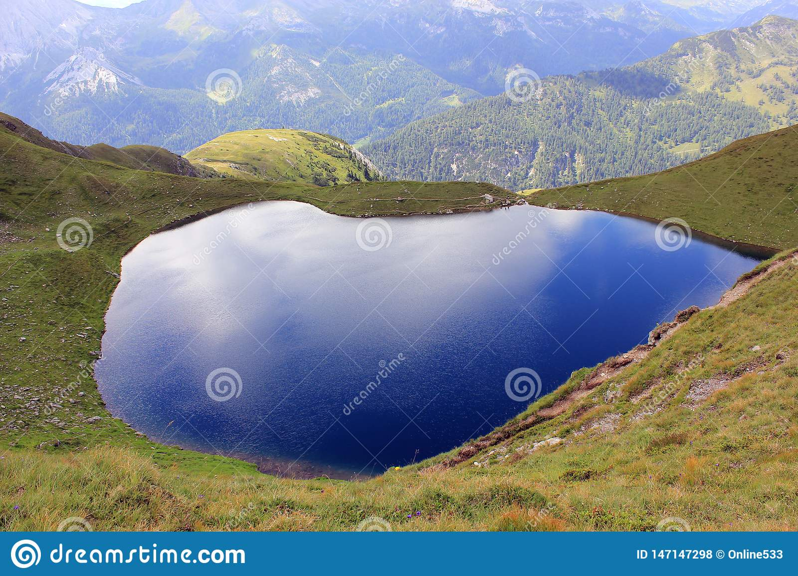 Picturesque blue glassy lake in the mountains