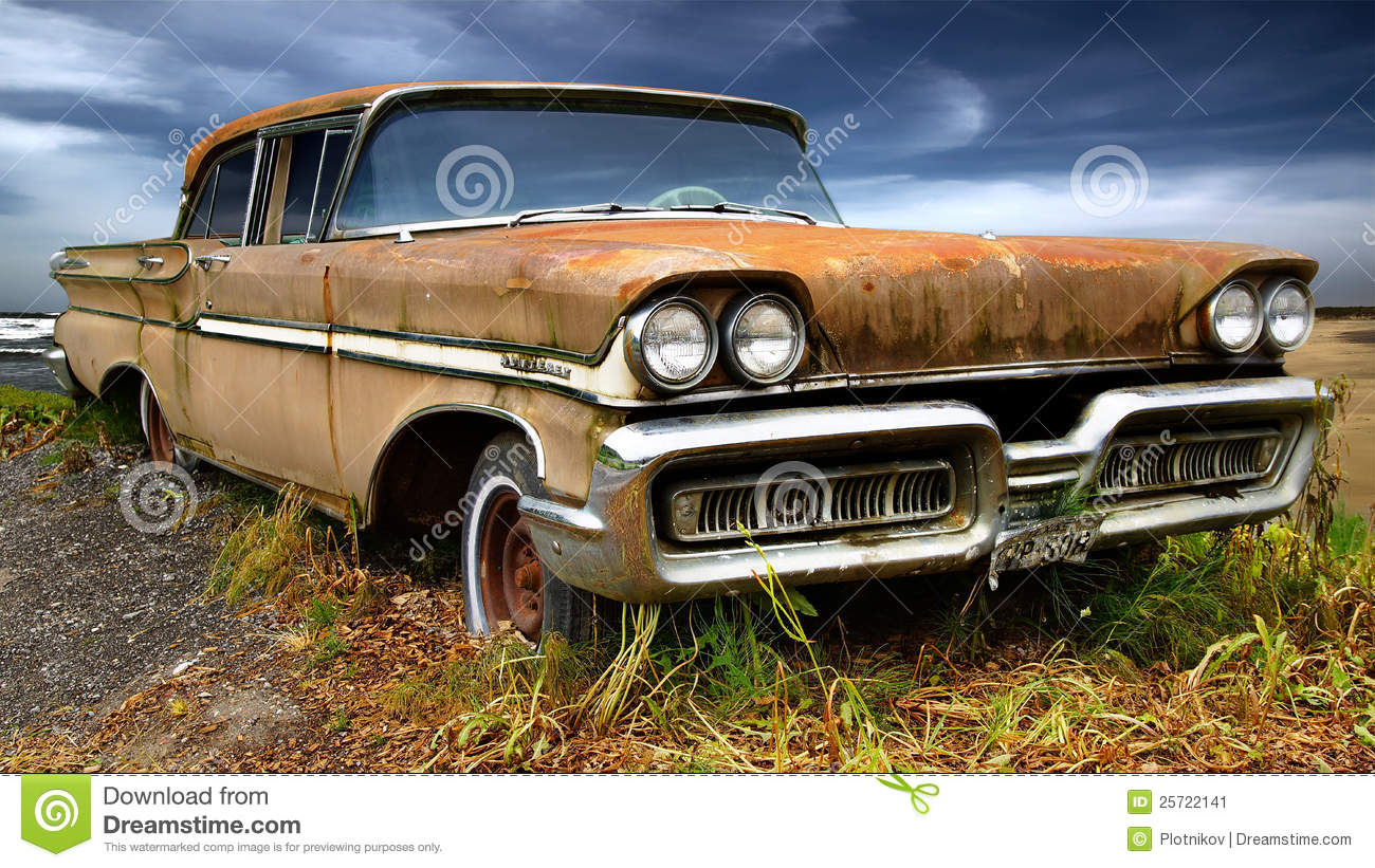Picturesque rural landscape with old car.
