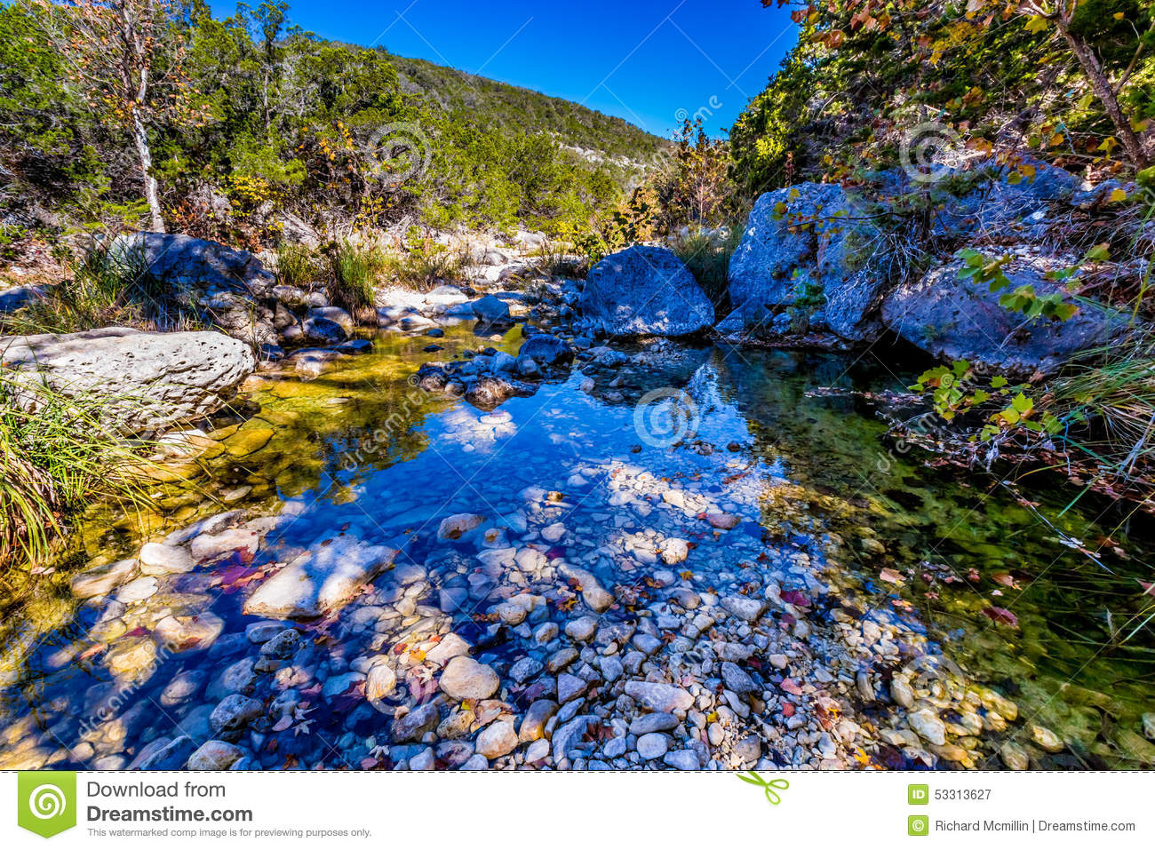 A Picturesque Scene with Fall Foliage on a Babbling Brook and Large Boulders at Lost Maples