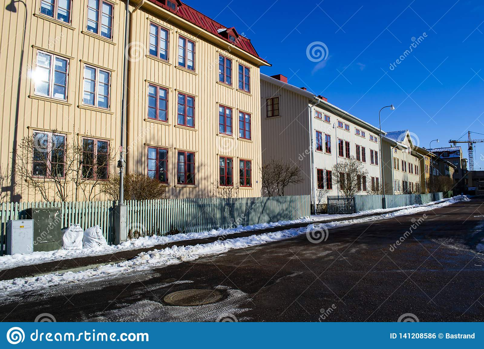 A picturesque street with old wooden houses in Sweden.