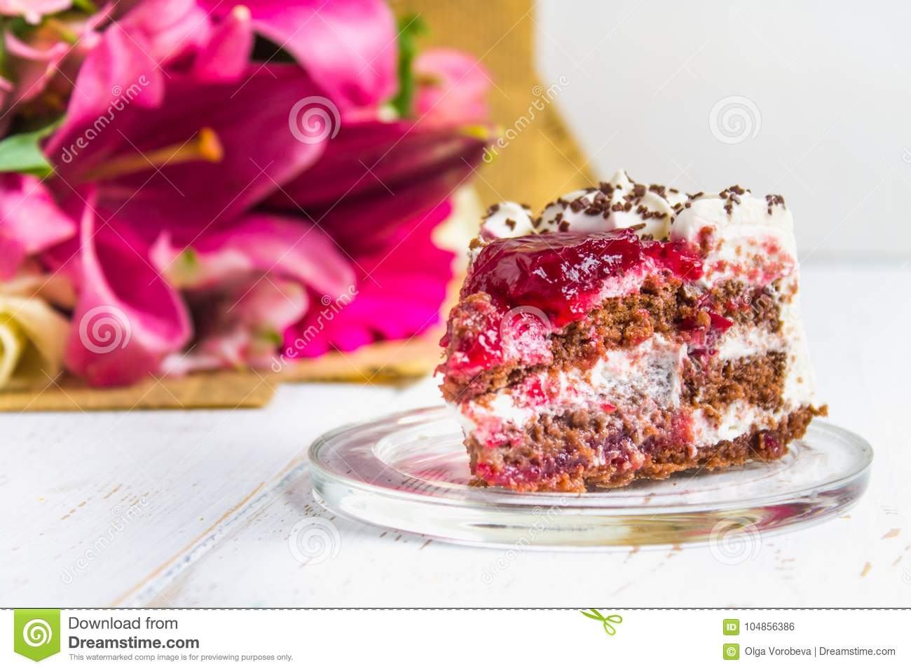 A piece of cake and a bouquet of flowers on a white wooden table a piece of cake and a bouquet of flowers on a white wooden table celebrating the birthday a gift izmirmasajfo